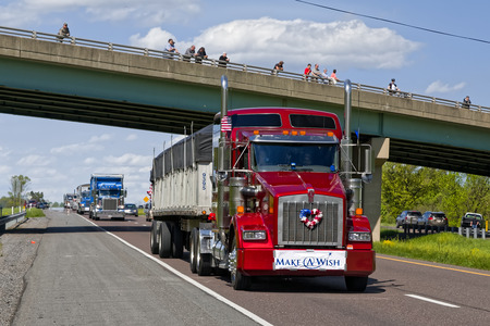 world record: LANCASTER, PENNSYLVANIA - MAY 8, 2016: Make-A-Wish Foundation sets a new Guinness World Record for the largest truck convoy with 590 trucks. On the Mothers Day annual fundraiser truckers grant a Lancaster County wish ride to children with life-threatenin