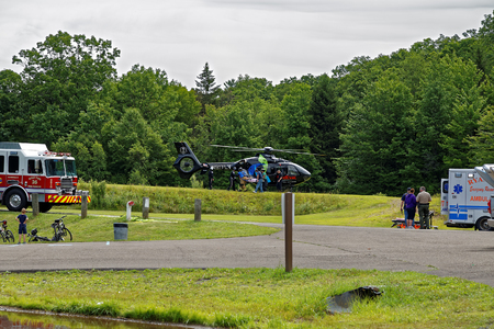 needing: BARNESVILLE, PA- JULY 3, 2016: A medical helicopter flies into Locust Lake State Park to transport a person needing emergency health care.