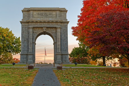 monument historical monument: A beautiful autumn sunrise at Valley Forge. The National Memorial Arch is a  monument dedicated to George Washington and the United States Continental Army. This monument is located at Valley Forge National Historical Park in Pennsylvania, USA. Stock Photo