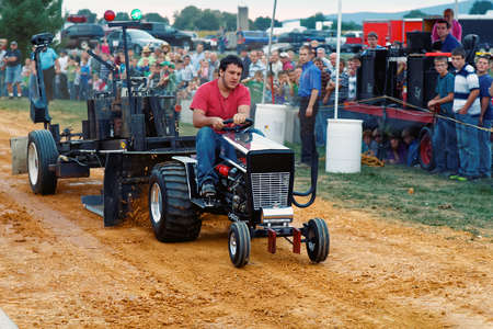 east end: MYERSTOWN, PENNSYLVANIA -  SEPTEMBER 16, 2016: A young man drives a modified lawn tractor at Myerstown East End Days. The tractor pull is an annual community event. Editorial