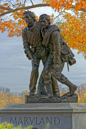 GETTYSBURG, PENNSYLVANIA - OCTOBER 31, 2015: A bronze statue by Lawrence M. Ludke of two wounded Marylanders, one Union and one Confederate, helping each other on the battlefield. It was dedicated on November 13, 1994.