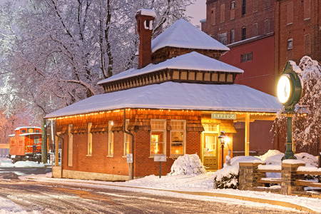 Snowfall at the old railroad station in Lititz, Pennsylvania.This building is now the town visitor center. Stock Photo