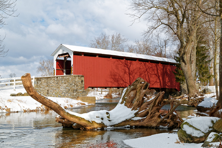 The Erbs Covered Bridge spans Hammer Creek in Lancaster County, Pennsylvania, USA. The bridge has a single span, wooden, double Burr arch trusses design with the addition of steel hanger rods. Stock Photo