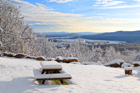 Sunrise on a snow covered mountain with a picnic table in the forground. Lancaster County, Pennsylvania, USA.