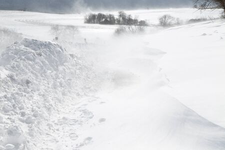 A rural road is closed with blowing drifting snow in Pennsylvania, USA.