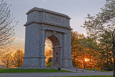 A springtime sunrise at Valley Forge National Historical Park in Pennsylvania, USA.The National Memorial Arch is a monument dedicated to George Washington and the United States Continental Army.