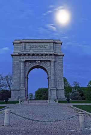 Springtime predawn moonlight at Valley Forge National Historical Park in Pennsylvania, USA.The National Memorial Arch is a monument dedicated to George Washington and the United States Continental Army.