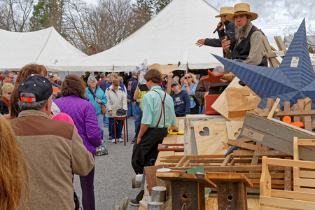 auctioneer: STRASBURG PENNSYLVANIA - February 25, 2017: Amish auctioneers volunteer at the annual Mud Sale to benefit the Fire Company. Sale items include quilts, antiques, crafts, food, sporting goods, tools, farm equipment and horses.