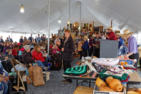 auctioneer: STRASBURG PENNSYLVANIA - February 25, 2017: Amish auctioneers volunteer at the annual spring auction Amish Mud Sale to benefit the Fire Company. Sale items include quilts, antiques, crafts, food, sporting goods, tools, farm equipment, and horses. Editorial