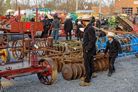 amish: STRASBURG PENNSYLVANIA - February 25, 2017: Annual spring auction Amish Mud Sale to benefit the Fire Company. Sale items include quilts, antiques, crafts, food, sporting goods, tools, farm equipment, and horses.