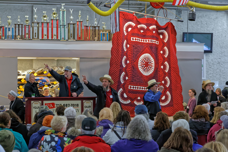 crowds of people: GORDONVILLE PENNSYLVANIA - March 11, 2017: Amish volunteers help at the annual quilt auction to benefit the Fire Company. Editorial