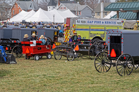 GAP PENNSYLVANIA - MARCH 25, 2017: Annual Amish Mud Sale to benefit Gap Fire Company. Multiple auctioneers sell quilts, tools, crafts, farm machinery and antiques.