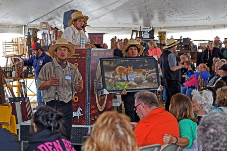 amish: GAP PENNSYLVANIA - MARCH 25, 2017: Amish volunteers sell art and craft items under a tent at the annual Amish Mud Sale to benefit Gap Fire Company. Editorial