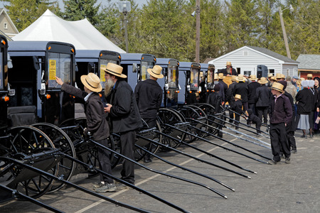 shopping buggy: GAP PENNSYLVANIA - MARCH 25, 2017: Amish men looking at new and used carriages at the annual Amish Mud Sale which benefits Gap Fire Company.