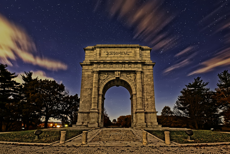 monument historical monument: Starlight just before sunrise at Valley Forge National Historical Park in Pennsylvania USA.The National Memorial Arch is a monument dedicated to George Washington and the United States Continental Army.