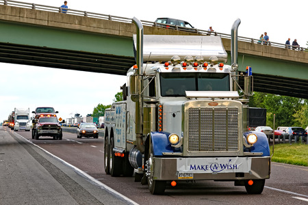 grant: LANCASTER PA - MAY 14 2017: Make-A-Wish Foundation sets a new record for the largest truck convoy. On the Mothers Day annual fundraiser truckers grant a Lancaster County wish ride to children with life-threatening illnesses.