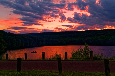 A cloudy sunset at Locust Lake State Park, Schuylkill County, Pennsylvania, USA.