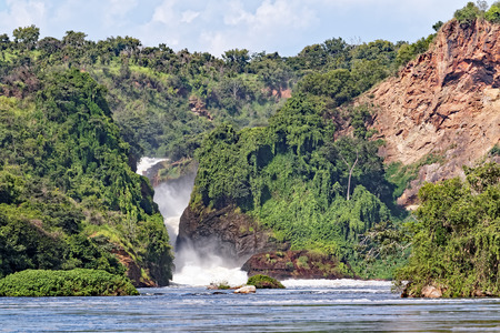Murchison Falls, also known as Kabalega Falls, is a waterfall between Lake Kyoga and Lake Albert on the Victoria Nile River in northern Uganda. Stock Photo