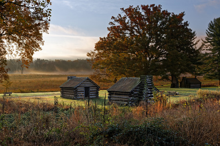 A misty morning at Valley Forge National Historic Park located in Valley Forge, Pennsylvania, USA. The buildings are reproductions of cabins used by Revolutionary War soldiers during the winter of 1777-78 under the command of George Washington.