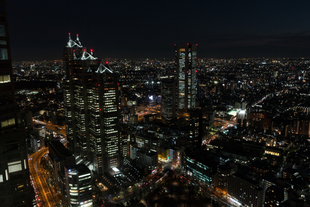 TOKYO, JAPAN - FEBRUARY 17: Shinjuku district night view through glass from Tokyo Metropolitan Government Building observation  February 17, 2017 in Tokyo, Japan