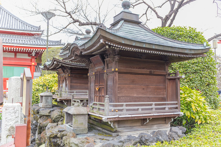 TOKYO, JAPAN - FEBRUARY 18: Japanese small religious building made by wood in the garden February 18, 2017 in Tokyo, Japan