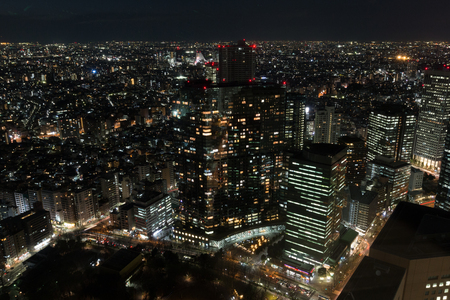 TOKYO, JAPAN - FEBRUARY 17: Shinjuku district at night, view through glass from Tokyo Metropolitan Government Building observation February 17, 2017 in Tokyo, Japan
