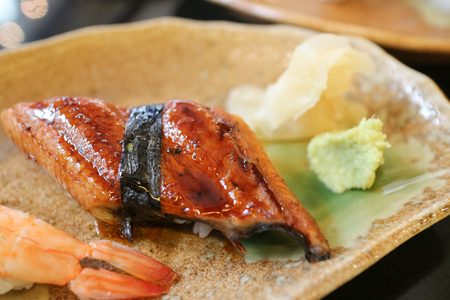 Unagi sushi or Japanese grill eel with wasabi and ginger Stock Photo
