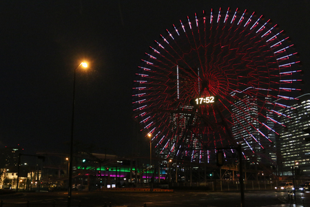 TOKYO, JAPAN - FEBRUARY 20: Cosmo Clock 21 is a giant Ferris wheel at the Cosmo World amusement park in the Minato Mirai 21 with raining February 19, 2017 in Tokyo, Japan