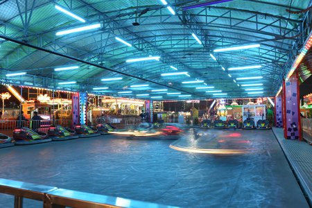 Bangkok, Thailand - April 28: long exposure abstract blurry light bumper cars are moving in amusement park at night April 28, 2016 at Bangkok, Thailand.