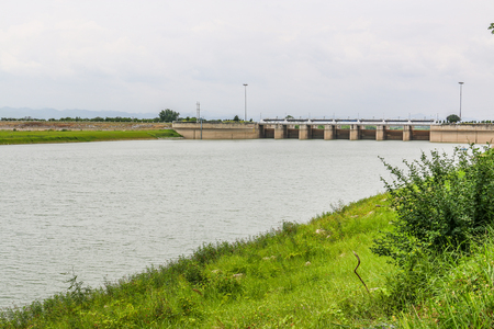 water is waiting for drainage at dam with green grass foreground