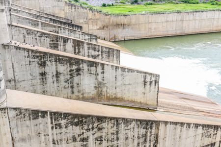 concrete dam structure and water behind