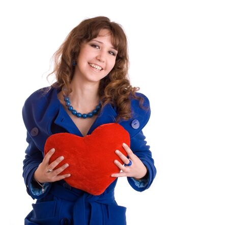 Beautiful young woman with fluffy heart pillow photo