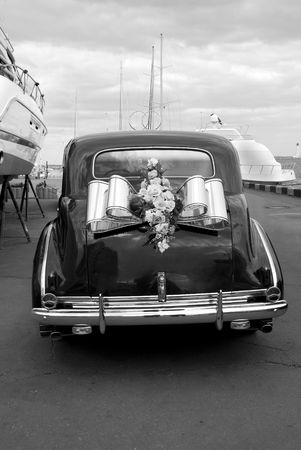 the mooring: The black wedding automobile on a mooring Stock Photo
