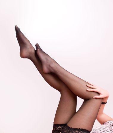 Elegant female legs in stockings isolate Stock Photo - 4798032