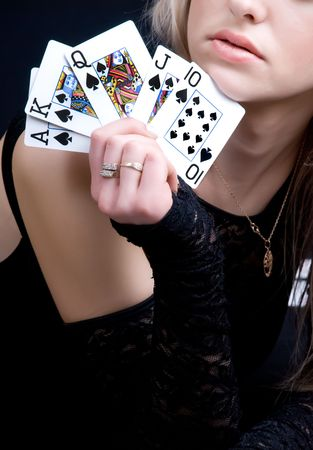 a sexy woman holding playing cards Editorial