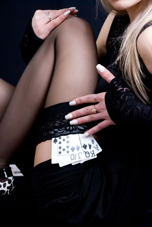 a sexy woman holding playing cards Stock Photo