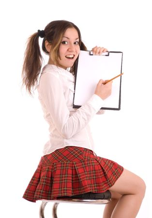 Graceful female student writing and showing the form in a folder. Stock Photo - 4853834