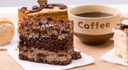 Biscuit cakes with cup of coffee photo