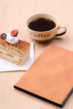 Biscuit cake with cup of coffee and book Stock Photo - 5133084