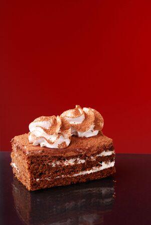 Appetizing cake on dark background photo