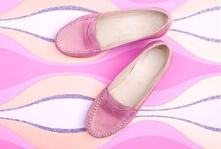 Stylish female shoes on a pink background Stock Photo - 5329066