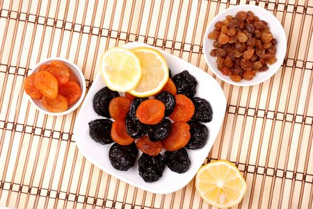 Collection of dried fruits on plates photo