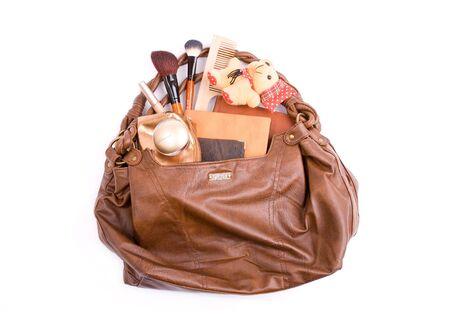 Stylish ladies\' handbag with cosmetics and toy a bear