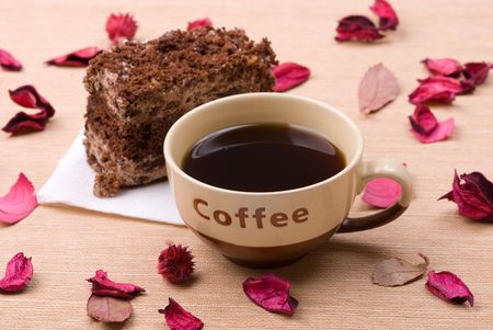 Biscuit cake with cup of coffee in petals photo