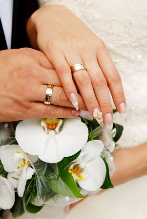 Just married couple hands on a bouquet Stock Photo - 5969068