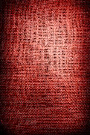 hilo rojo: Fragmento de fondo de �spera textil rojo Foto de archivo