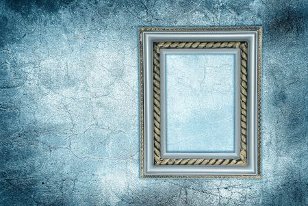 antique frame on a frozen grunge wall photo