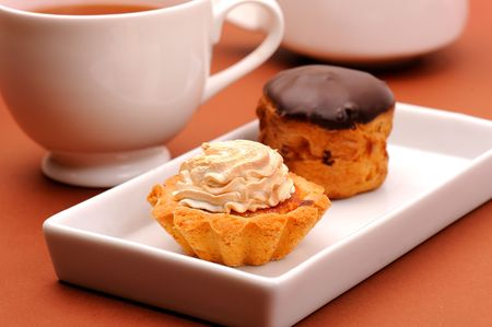 Cakes with tea in cafe photo