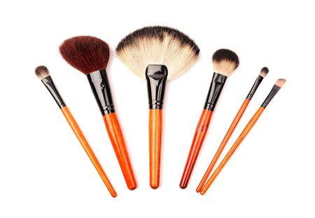 Set of cosmetic brushes isolated on white photo
