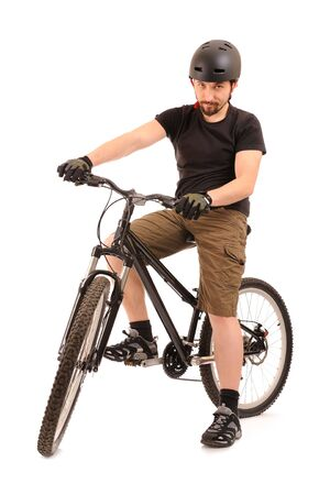 The bicyclist isolated on white, studio shot. Stock Photo - 6528811